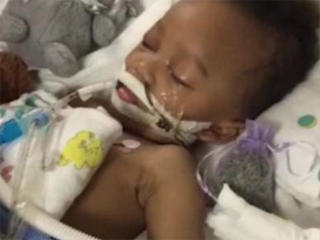 Hospital takes 2-year-old brain dead off life support after court ruling
