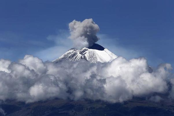 World's most dangerous volcanoes of Popocatépetl billowing vast clouds of black smoke and ash