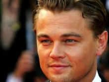 Hirst art, DiCaprio space trip help raise record AIDS funds